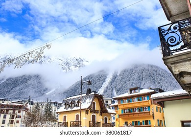 Chamonix town with snowy mountains on the background. Chamonix-Mont-Blanc was the site of the first Winter Olympics in 1924 and it's one of the oldest ski resorts in France.