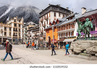 CHAMONIX-MONT-BLANC, FRANCE - APRIL 1, 2018 : Center of Chamonix village and monument of Saussure and Balmat. Chamonix is one of the oldest ski resorts in France.