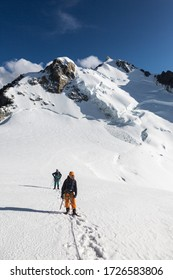Chamonix-Mont-Blanc / France- August 04, 2019: Alpinists on the Mont Blanc three mounts route over Mont-blanc du Tacul, Mont Maudit and the main Alps mount Mont-Blanc. View on the Mont Maudit