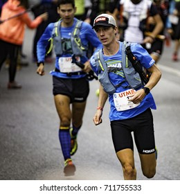 Chamonix-Mont-Blanc, France - September 1, 2017: Jim Walmsley of USA (#1) makes his way through the streets of Chamonix (with Sage Canaday following) at the start of the Ultra-Trail du Mont-Blanc.