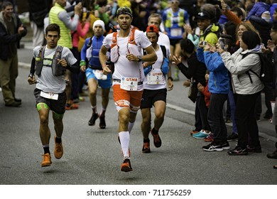 Chamonix-Mont-Blanc, France - September 1, 2017: François d'Haene of France (#4) makes his way through the streets of Chamonix at the start of the Ultra-Trail du Mont-Blanc.
