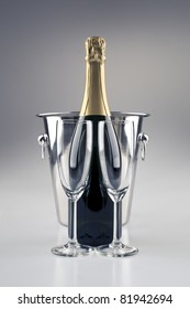 Champagne bottle and cooler and two glasses