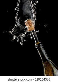 Champagne up from a bottle with drops