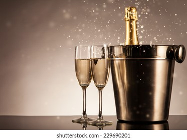 Champagne bottle with glasses. Celebration theme with champagne still life