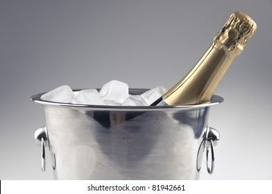 a champagne bottle in a ice bucket