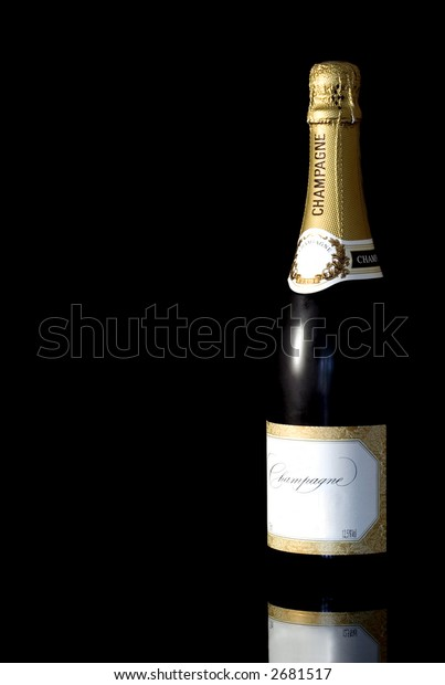 Champagne bottle isoalted against a black background with reflection