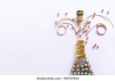 Champagne bottle made from decorations including baubles and ribbon