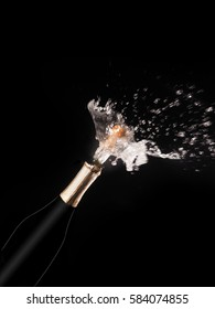 Champagne bottle and spray on black backgroun.
