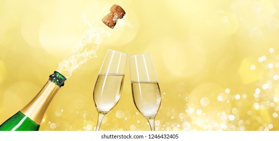 Champagne bottle with two champagne glasses and copy space