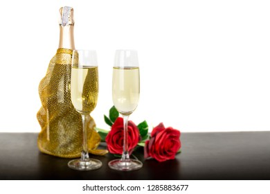 Champagne bottle two glasses and red rose flowers Isolated on white background.