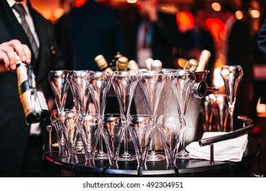 Champagne Bottle Wine Chrystal Glasses Set in Night Club Bar at Expensive Luxury Cocktail Party Celebration
