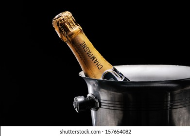 Champagne in bucket on black
