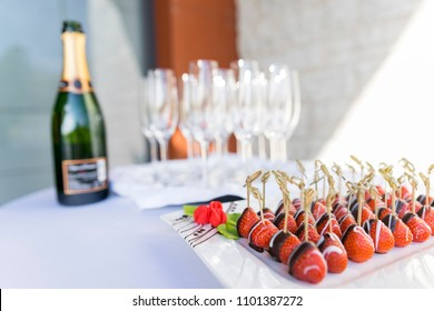 Champagne and chocolate covered strawberries served as an appetizer snack  and welcome drink