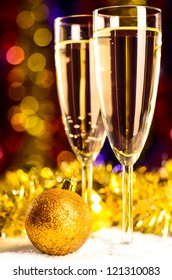 champagne with christmas toys on blurred background