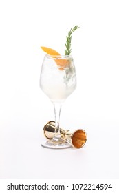champagne cocktail at wineglass decorated with rosemary on white background