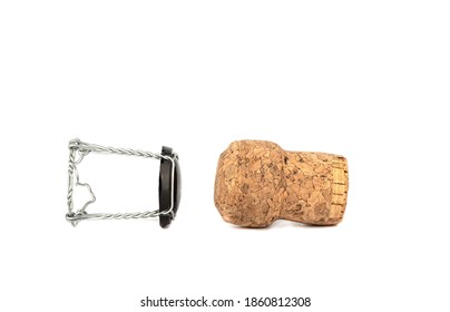 Champagne cork and muselet separately on a white background. Copy space. Close up.