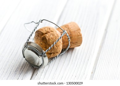 champagne cork on white table
