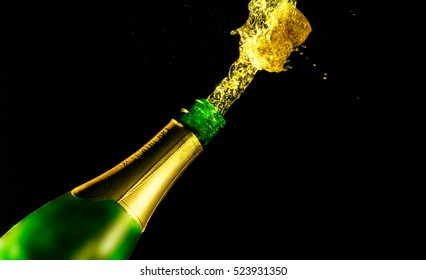 The champagne cork shot isolated on black