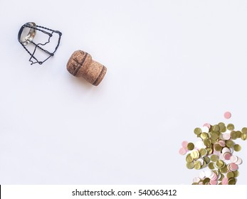 champagne cork, stopper and confetti. new year celebration background
