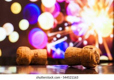 Champagne corks with firework background at new year
