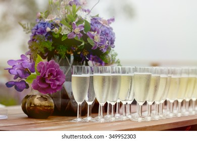 Champagne cups with flowers on wedding - fresh welcome drink