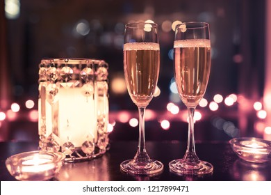 Champagne drinks in a romantic candle light setting.