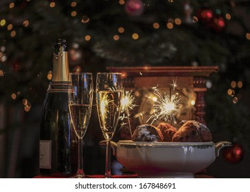 Champagne, Dutch 'oliebollen' a clock and sparkles for new year's eve.