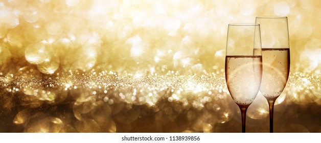 Champagne with festive gold background and shiny bokeh effects for a wedding