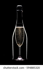 Champagne flute and bottle on black background
