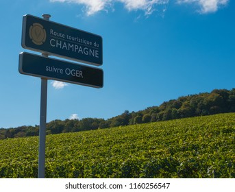 Champagne / France - September 29 2017: Signpost showing the Route du Touristique Champagne with a vineyard in the background