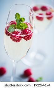 champagne with fresh raspberries