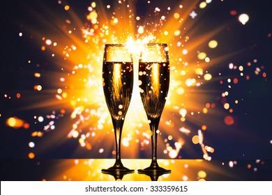 champagne glass against sparkler background