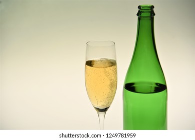 champagne glass with bottle on white background