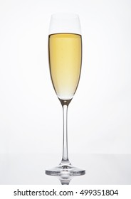 Champagne glass with bubbles on white background