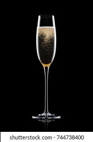 Champagne glass with bubbles with reflection on black background
