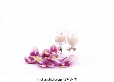 Champagne glass candles and purple tulip petals