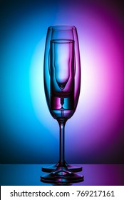Champagne glass on color background n studio