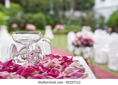 Champagne glass and rose petals at a wedding ceremony
