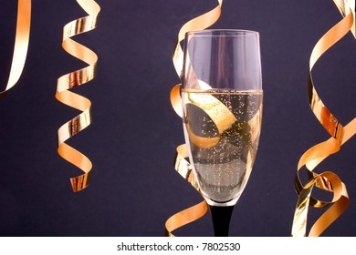 champagne in a glass and streamers, with copyspace