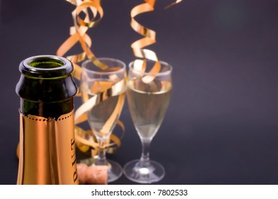 champagne glasses and bottle, with copyspace