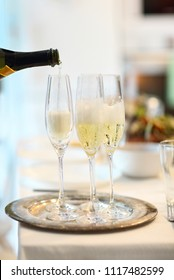 Champagne glasses and bottle in restaurant. Close up