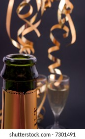 champagne glasses and bottle, shallow dof, focus is on the bottle