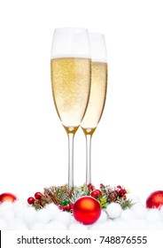 Champagne glasses with christmas decoration on white background