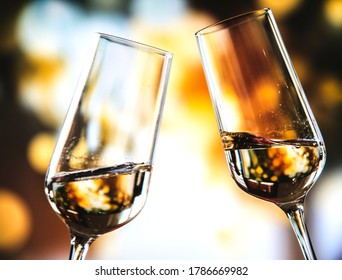 champagne in glasses close-up. romantic setting. champagne is poured into glasses.