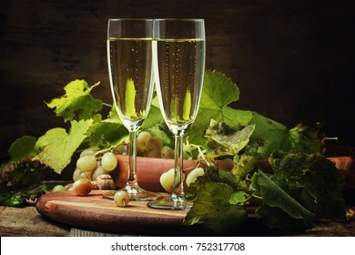 Champagne In Glasses, Grapes With Vine, Vintage Wood Background, Selective Focus