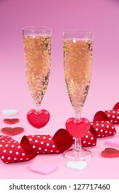 Champagne glasses with heart,  ribbon and rose petals