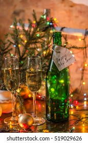 Champagne in glasses on the background of garlands, for an inscription, new year