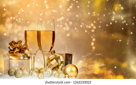 Champagne glasses on sparkling holiday background and fireworks - New Year concept