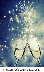 Champagne glasses on sparkling holiday background