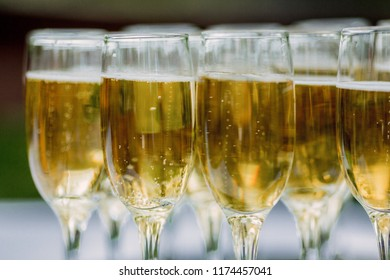 champagne in glasses on the street close up - wedding catering